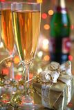 Champagne in glasses, gift box and lights Royalty Free Stock Photography