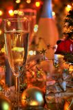 Champagne in glasses, gift box and lights Stock Photos