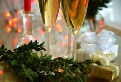Champagne in glasses and gifts Royalty Free Stock Photos