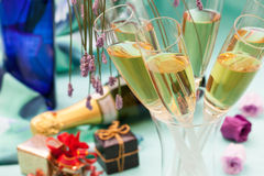 Champagne glasses and gifts Royalty Free Stock Image