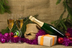 Champagne glasses with gifts Royalty Free Stock Images