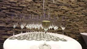 Champagne in glasses, a glass of champagne, banquet design, champagne close-up, banquet interior, indoors stock video
