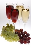 Champagne glasses with grapes on Stock Image