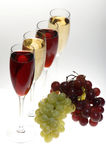 Champagne glasses with grapes Stock Photography