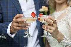 The champagne glasses in the hands of the newlyweds. Royalty Free Stock Photography