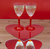 Champagne glasses in heart Stock Photography