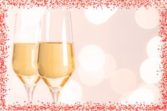 Champagne glasses with hearts and Blurred background. For wedding Royalty Free Stock Images