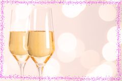 Champagne glasses with hearts and Blurred background. For wedding Stock Images