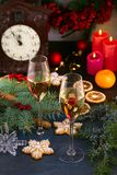 Champagne glasses in holiday setting. Christmas and New Year celebration with champagne. Christmas holiday decorated table with wh Stock Image