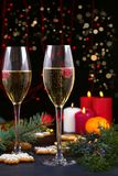 Champagne glasses in holiday setting. Christmas and New Year celebration with champagne. Christmas holiday decorated table with wh Royalty Free Stock Photos