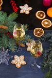 Champagne glasses in holiday setting. Christmas and New Year celebration with champagne. Christmas holiday decorated table with wh Stock Photo