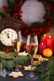 Champagne glasses in holiday setting. Christmas and New Year celebration with champagne. Christmas holiday decorated table with wh Stock Images