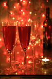 Champagne in glasses and lights Royalty Free Stock Photos