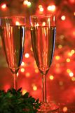 Champagne in glasses and lights Stock Photography