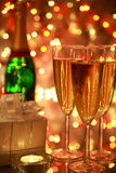 Champagne in glasses and lights Stock Photos