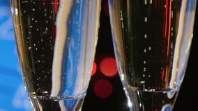 Champagne into glasses on New Year Eve against stock video footage