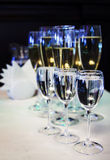 Champagne in the glasses. New years toys on the table. The black background. New year card. Christmas picture. Champagne glasses and Christmas toys. 2016, xmac Stock Photos