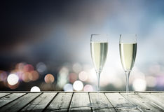 Champagne Glasses. And night city Royalty Free Stock Photography
