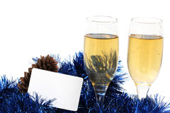 Champagne glasses. With a plastic card for the new year Royalty Free Stock Image