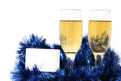 Champagne glasses. With a plastic card for the new year Stock Images