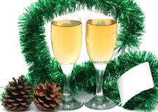 Champagne glasses. With a plastic card for the new year Royalty Free Stock Photos