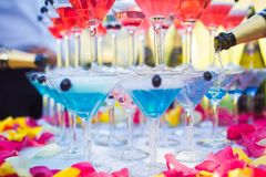 Champagne in glasses. Pouring champagne in glasses, for an event. Wedding event royalty free stock image