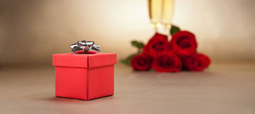 Champagne glasses, present and roses Stock Photography