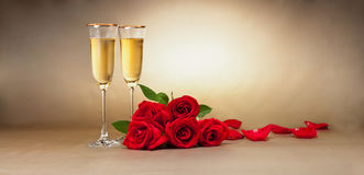 Champagne glasses, present and roses Royalty Free Stock Images