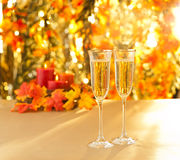 Champagne glasses for reception in front of autumn background Stock Images