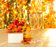 Champagne glasses for reception in front of autumn background Royalty Free Stock Image