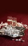 Champagne glasses on red Royalty Free Stock Image