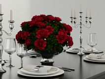 Champagne glasses and red flowers Stock Image