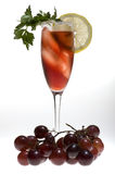 Champagne glasses with red grapes Royalty Free Stock Image