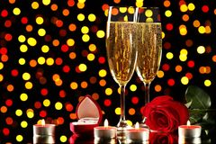 Champagne glasses with red rose royalty free stock photos
