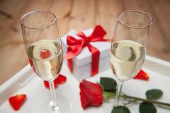 Champagne glasses and red rose Stock Photos