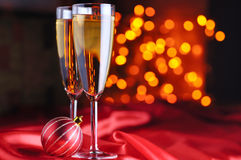 Champagne glasses on red silk Royalty Free Stock Image