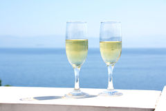 Champagne glasses with sea background Stock Photos