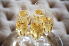 Champagne glasses on silver tray. Party and holiday celebration concept Stock Images