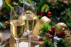 Champagne glasses on snow. Champagne glasses and christmas balls on snow Royalty Free Stock Photos