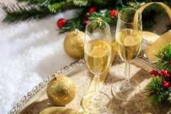 Champagne glasses on snow. Champagne glasses and christmas balls on snow Royalty Free Stock Image