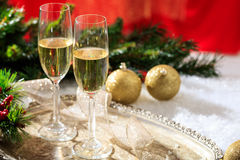 Champagne glasses on snow Royalty Free Stock Photos