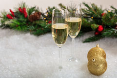Champagne glasses on snow. Champagne glasses and christmas balls on snow Stock Photos