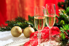 Champagne glasses on snow. Champagne glasses and christmas balls on snow Stock Image
