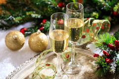 Champagne glasses on snow. Champagne glasses and christmas balls on snow Stock Images