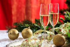 Champagne glasses on snow. Champagne glasses and christmas balls on snow Stock Photography