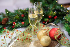 Champagne glasses on snow. Champagne glasses and christmas balls on snow Royalty Free Stock Photography