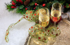 Champagne glasses on snow. Champagne glasses and christmas ornaments on snow Royalty Free Stock Image