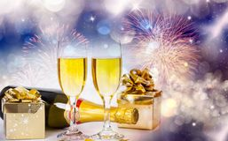 Champagne glasses on sparkling background. Glasses with champagne and Christmas decoration against fireworks and holiday lights - Celebrating the New Year Stock Photography