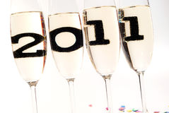 Champagne glasses with sparkling wine in 2011 V4. Champagne glasses with sparkling wine and 2011 inside Royalty Free Stock Photography