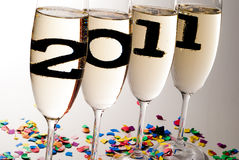 Champagne glasses with sparkling wine in 2011 V5. Champagne glasses with sparkling wine and 2011 inside Stock Photo